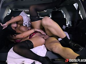 Romi Rain ravaged in the back of the car