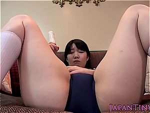 lovely japanese makes her innate vag dousing wet