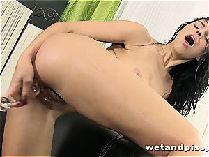 huge-chested Elena Rae pisses thru her stocking