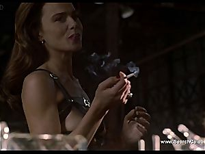 dark haired Lena Olin in lingerie flashes off her puny jugs