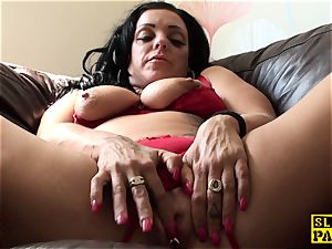 draining uk skank toying her moist labia