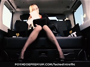 pummeled IN TRAFFIC Tina Kay footjob in the backseat