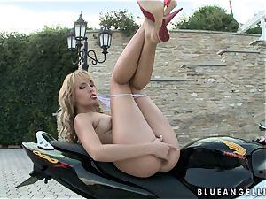Blue Angel rubbin' her clit while on her motor bike