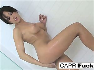 Capri likes to finger her cock-squeezing cunt