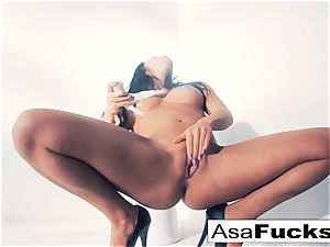 Asa Akira uses a faux arm to please her fuckbox