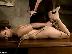Mandy Bright bind a splendid naked stunner on the table