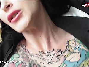 tatted milf needs a rock hard pecker to play with