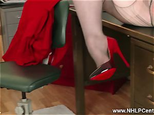 ginger-haired cougar frigs labia on office desk in stockings